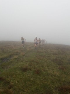 Runners emerging from the cloud