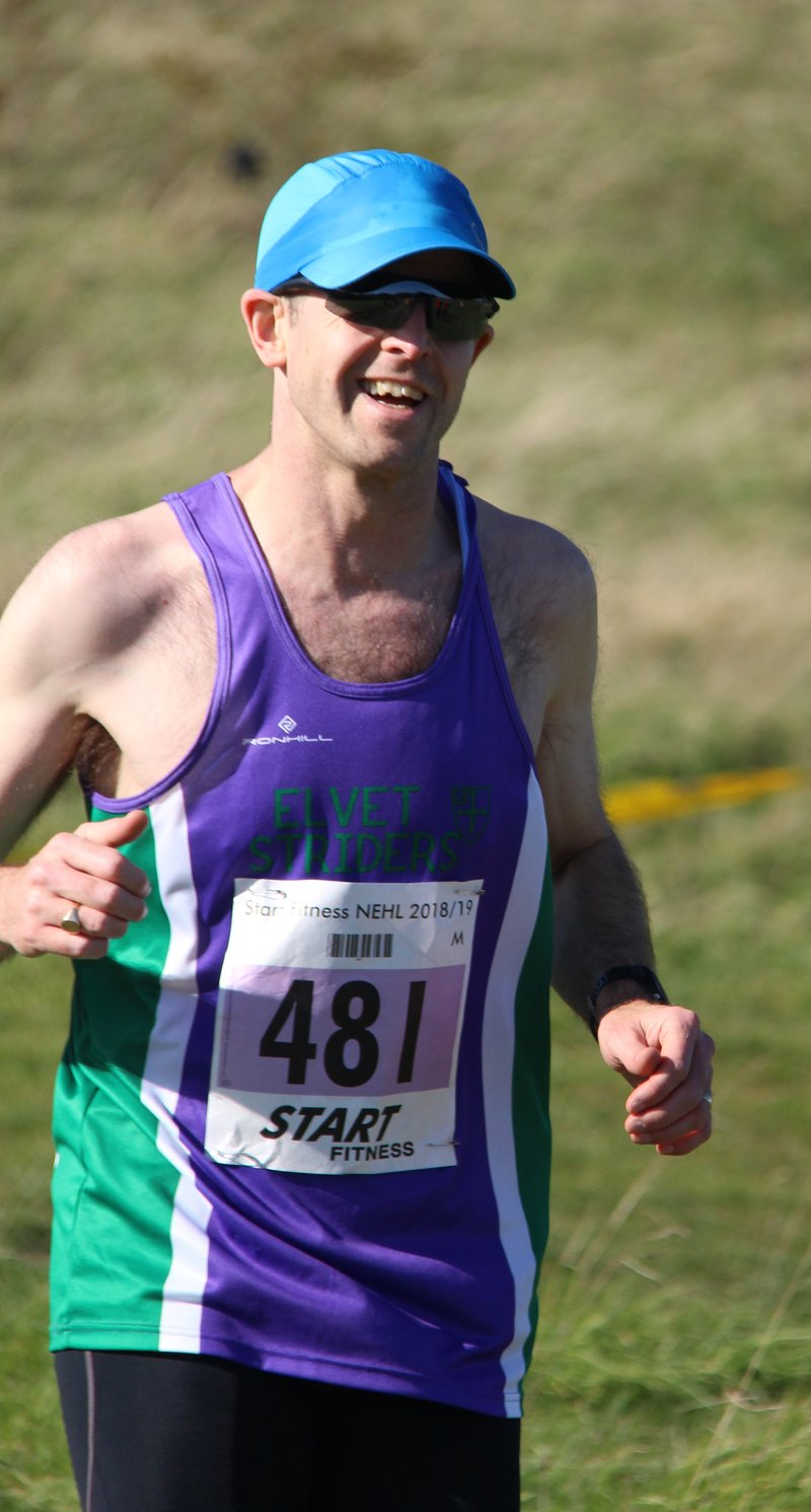 Right – smiling for the camera, getting a decent race photo